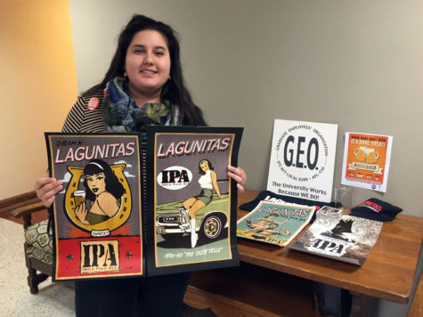 Sameerah Ahmad, one of Graduate Employees' Organization's two union organizers, stands with promotional materials for the GEO's first Craft Beer Night planned for Saturday from 7 to 10 p.m. at the Indi Go Artist Co-op and Gallery.