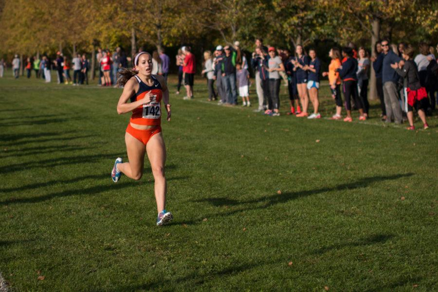 Illinois' Colette Falsey sprints towards the finish line at the Illini Open 2014 at the Arborteum on October 25.
