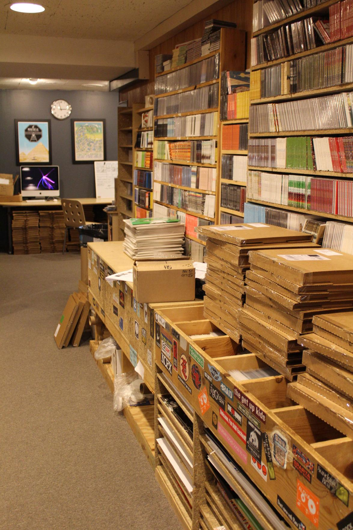 Vinyl records stack the shelves of Polyvinyl Record Co.'s offices in downtown Champaign.