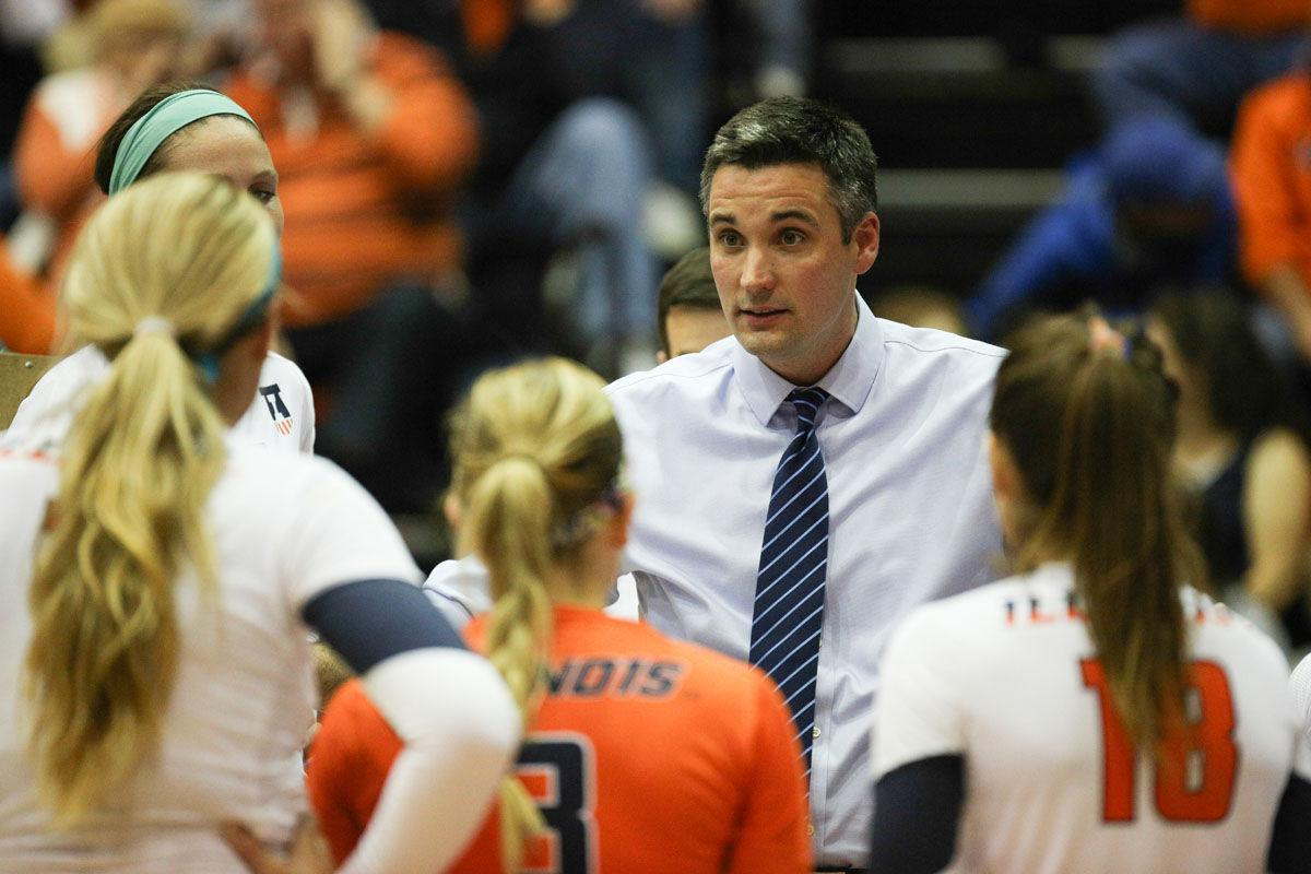 Illinois head coach Kevin Hambly talks to his team during a time-out during the game against Rutgers at George Huff Hall, on Saturday, Sept. 27th. The Illini won 3-0.