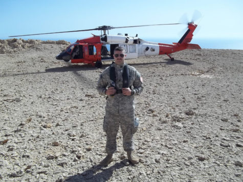 Alex Braem, senior in LAS and member of the National Guard, stands on a resupply mission on Turan Island in the Red Sea in March 2012.