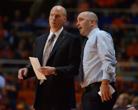 Illinois' head coach John Groce and assistant coach Dustin Ford talk during the game against Brown at State Farm Center on Monday, Nov. 24, 2014. The Illini won 89-68.