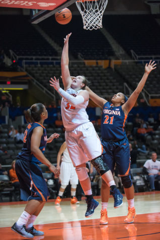 Illinois' Chatrice White attempts a layup during the game against Virginia at the State Farm Center on Dec. 4.The Illini won 86-63.