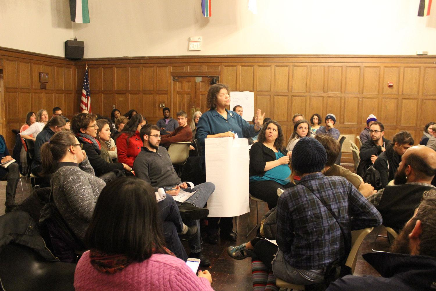 A faculty member shares the highlights her group discussed and explained their choice not to take notes.