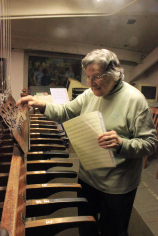 Chimesmaster Sue Woods practices on the chimes in Altgeld Hall.