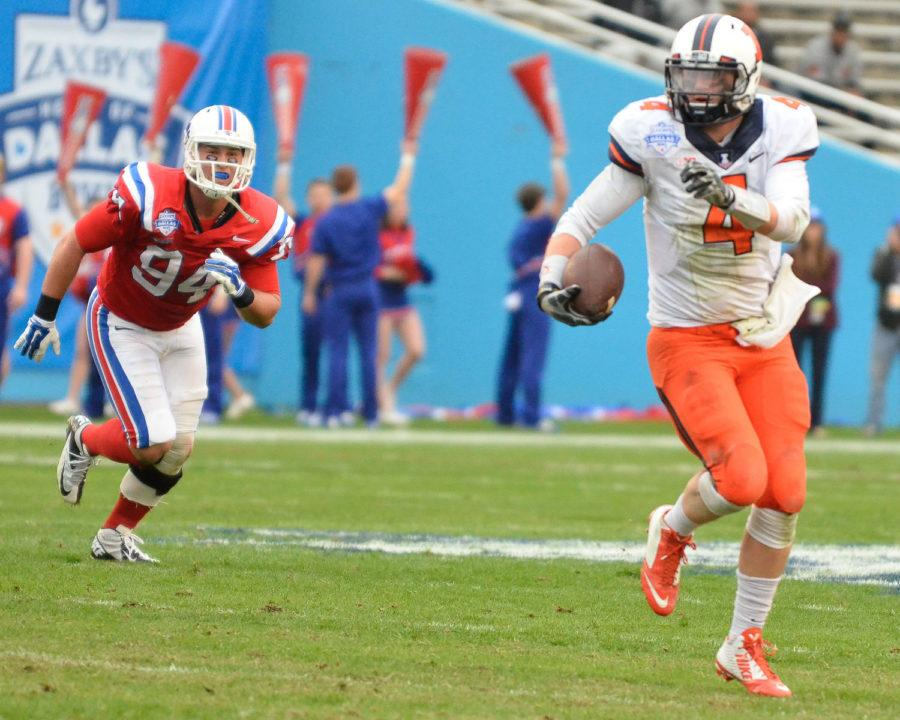 Louisiana Tech's Houston Bates (94) chases after Illinois' Reilly O'Toole (4) during the game at Cotton Bowl Stadium in Dallas, Texas on Friday, Dec. 26, 2014. The Illini lost 35-18.