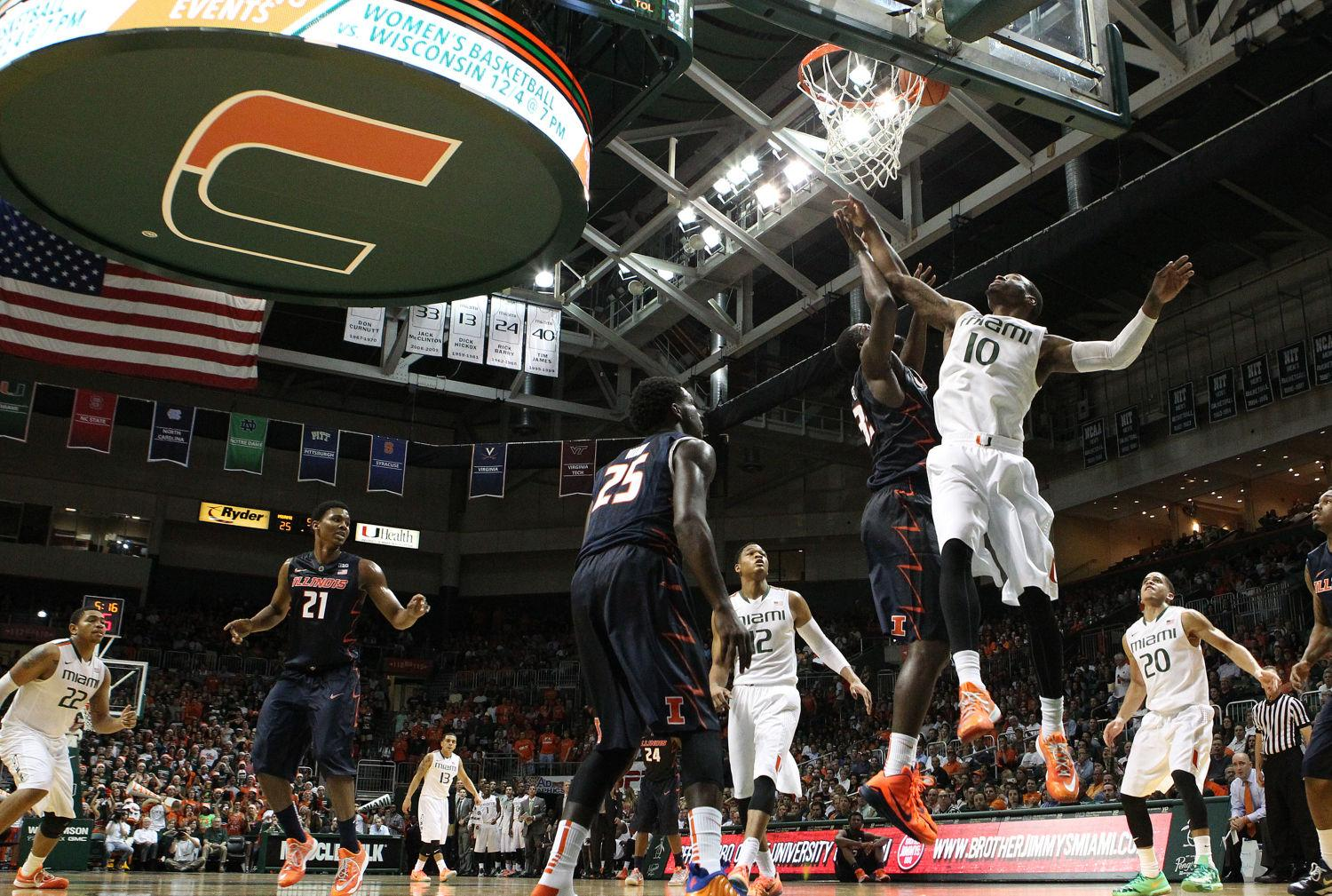 Miami's Sheldon McClellan goes to the basket to score in the first half against Illinois in Coral Gables, Florida, on Tuesday. The Hurricanes won, 70-61. The Illini's shooting percentage was their season-worst at 33.3 percent.