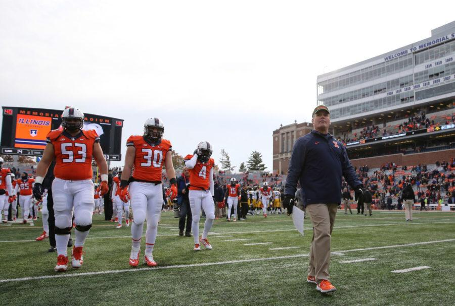 Illinois%27+head+coach+Tim+Beckman+walks+towards+the+%22Block+I%22+after+the+game+against+Iowa+at+Memorial+Stadium+on+%C2%A0Nov.+15.+Beckman+will+return+as+head+coach+for+the+Illini+in+2015.%C2%A0