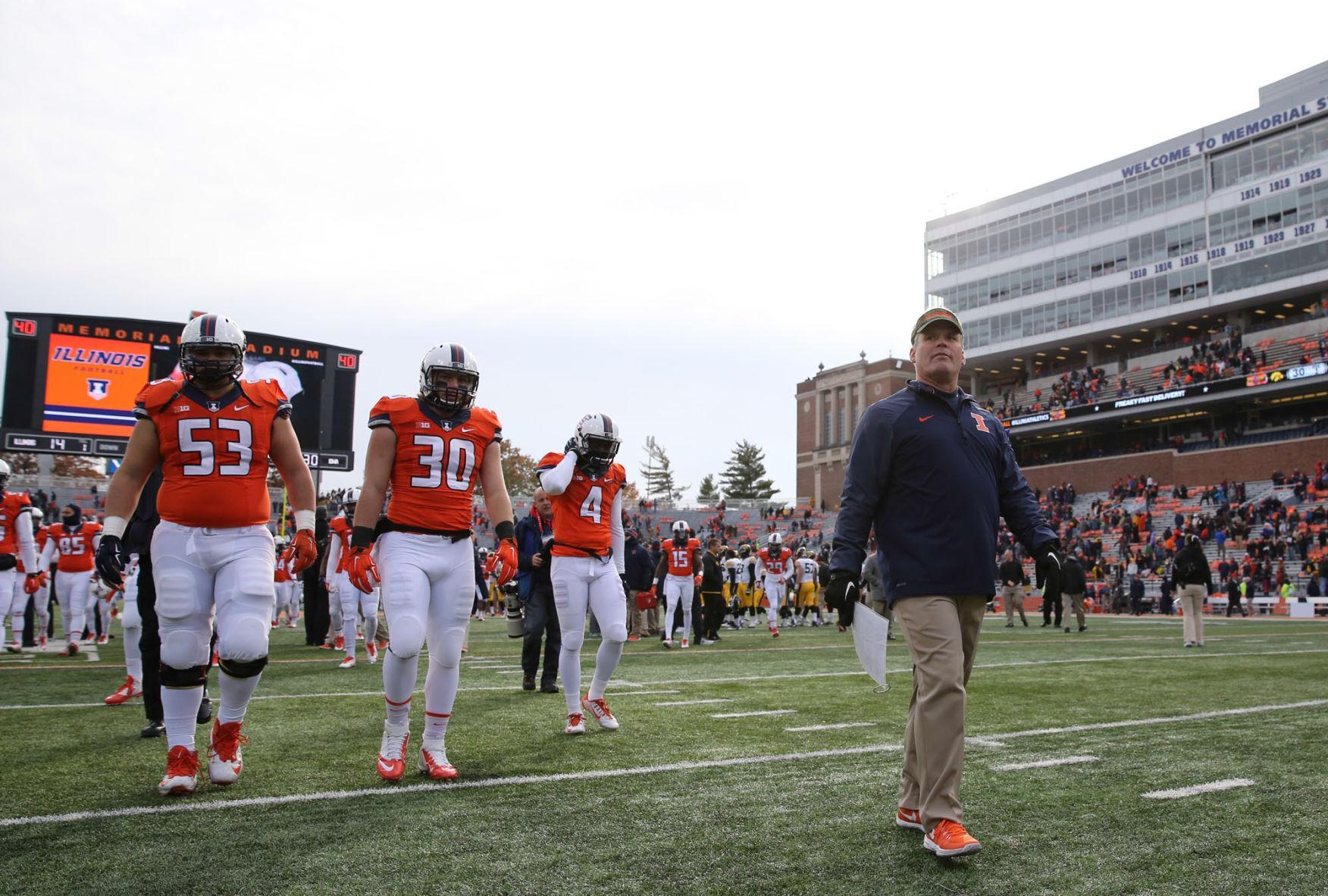 Illinois' head coach Tim Beckman walks towards the