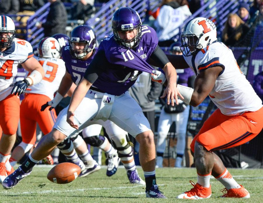 Illinois' Jihad Ward forces Northwestern's Zack Oliver to fumble the ball during the game at Ryan Field in Evanston, Ill., on Saturday. The Illini won 47-33.