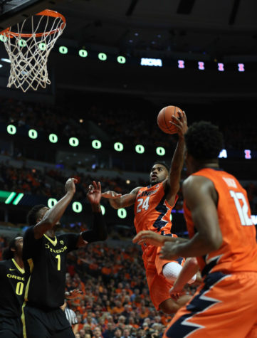 Illinois' Rayvonte Rice (24) rises for a shot during the game against Oregon at United Center in Chicago, Illinois on Dec. 13, 2014. The Illini lost 70-77.