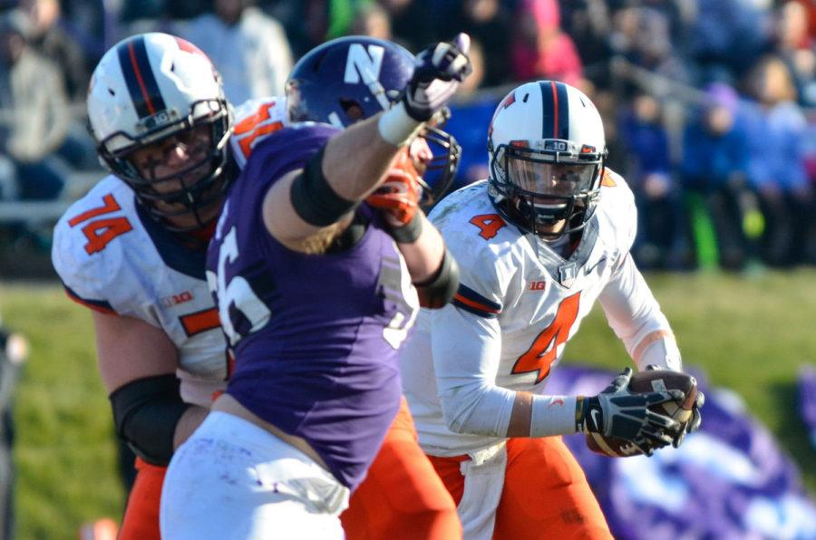 Illinois' Reilly O'Toole runs the ball during the game against Northwestern at Ryan Field on Saturday. The Illini won 47-33.