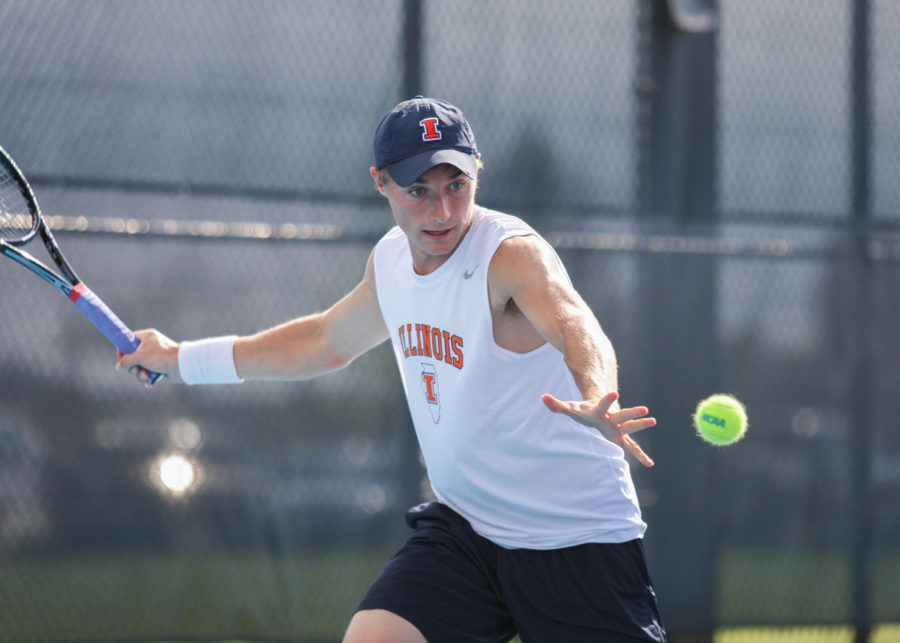 Illinois%27+Tim+Kopinski+prepares+to+hit+the+ball+back+during+the+first+round+of+NCAA+Tennis+Regionals+against+Ball+State+University+at+Khan+Outdoor+Tennis+Complex+on+May+9.+The+Illini+won+4-0.