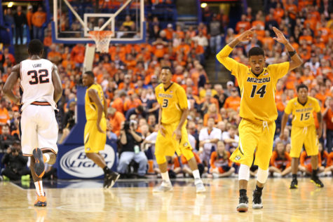 Missouri's Keith Shamburger (14) attempts to rile the crowd during the game against Missouri at Scottrade Center in St. Louis, Missouri on Dec.20, 2014. The Illini won 62-59.