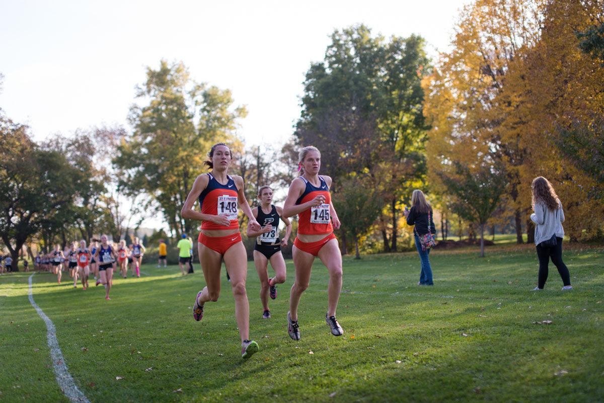 Illinois' Hanna Winter (148), sophomore, and Britten Petrey (145), junior, pace themselves at the Illini Open 2014 at the Arborteum on Oct. 25th, 2014.