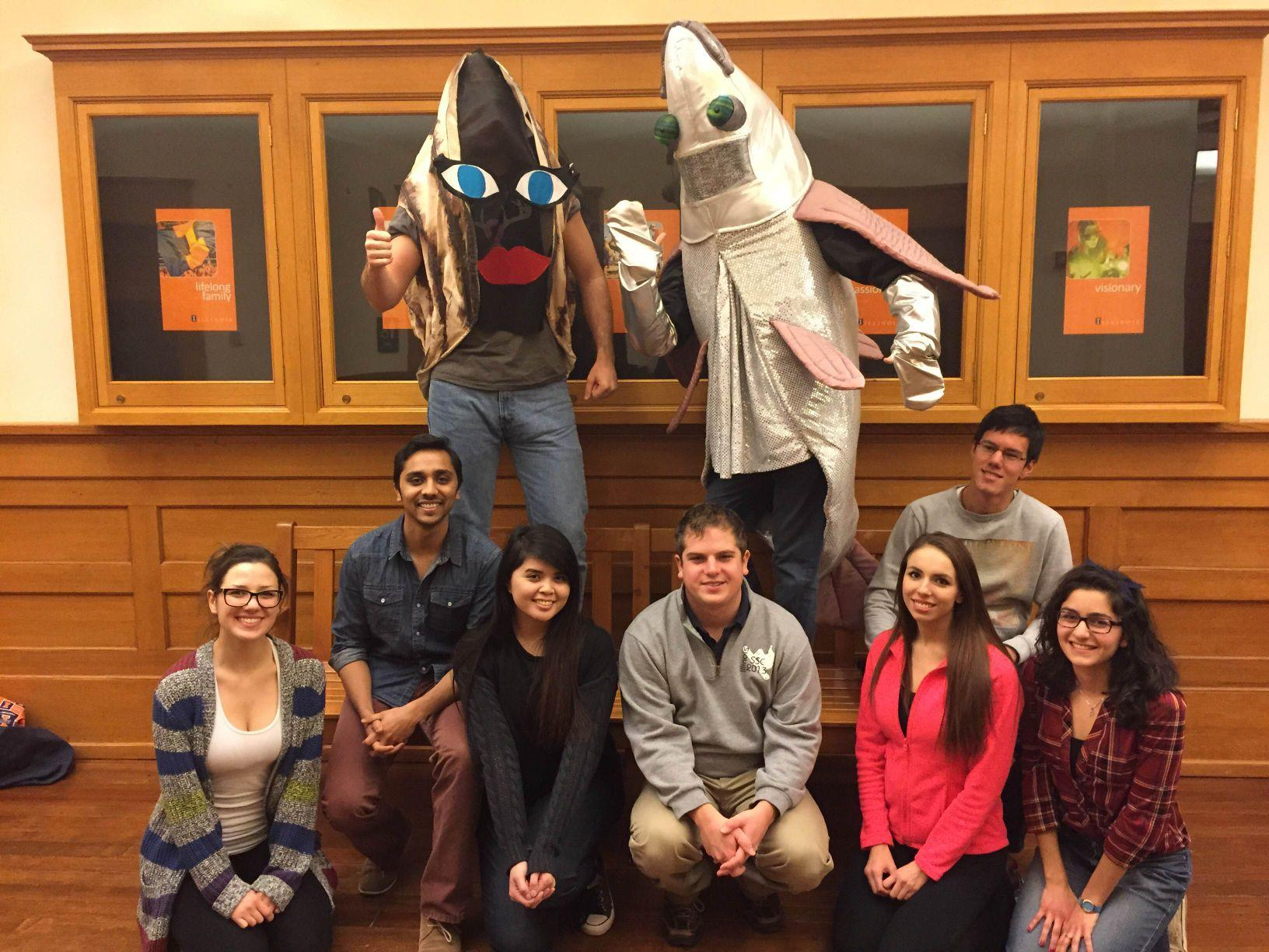 Students in an ENG 315 Learning in Community (LINC) class pose with fish costumes to advertise for the Medicine Take-back Event on Thursday at the Illini Union.
