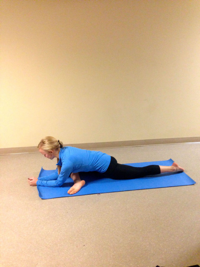 Meghan Drew, freshman in Engineering, demonstrates various yoga poses.