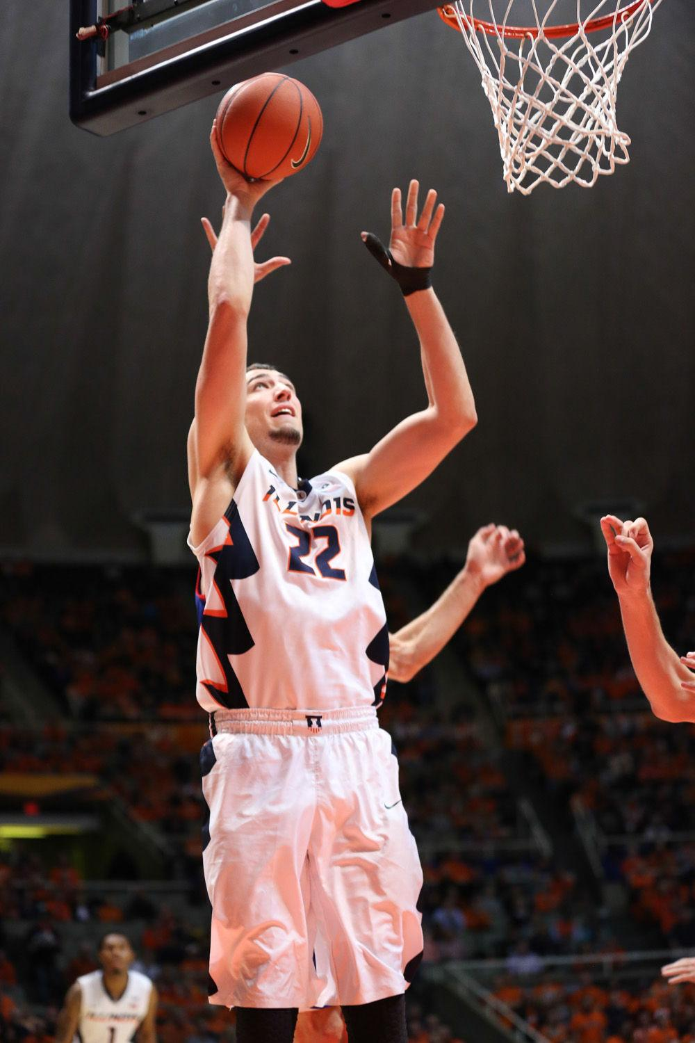 Illinois' Maverick Morgan attempts a close-range shot during the game against American at State Farm Center on Dec. 6. Morgan scored eight points in 11 minutes, plus four rebounds