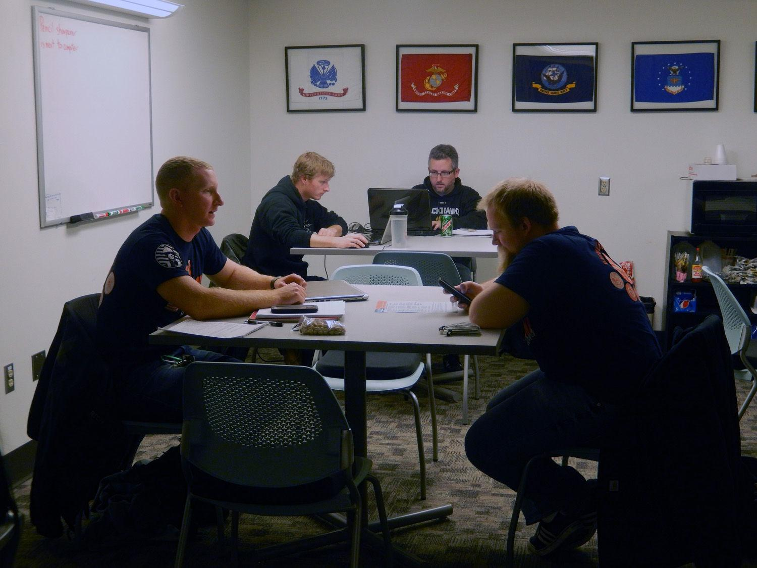 """Veteran students study in the Veteran Student Lounge in the basement of Illini Union on Monday. Study groups allow student veterans to be with """"like-minded people."""""""