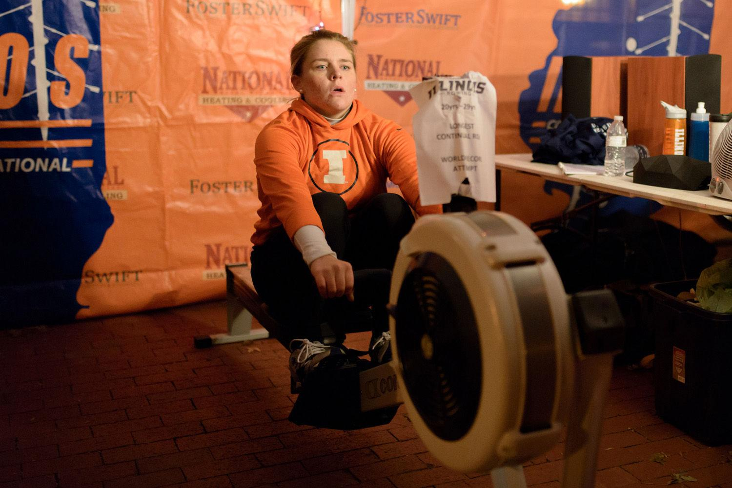 Elizabeth Dunne, senior in Media and member of the rowing team, attempts to break records for continuous rowing at the anniversary plaza on Sunday.