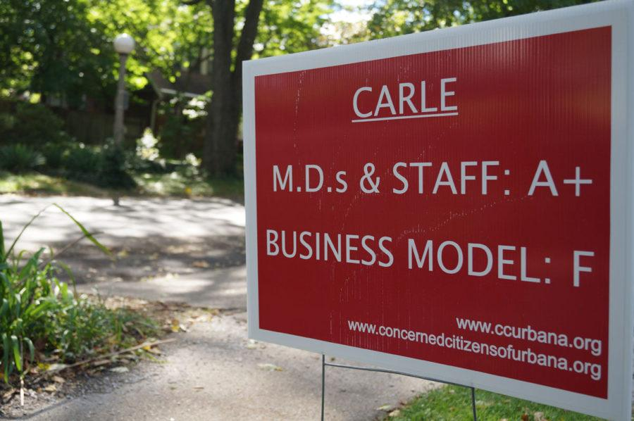 Urbana Residents opposed to Carle Foundation Hospital's status tax exemption for charity work have been posting signs in their yards to show their disapproval.