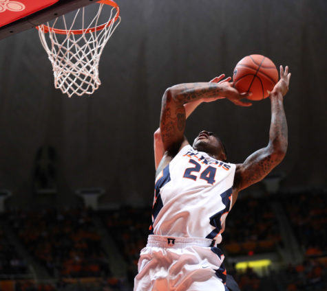 Illinois' Rayvonte Rice (24) draws contact while attempting a shot during the game against Kennesaw State at State Farm Center on Dec. 27, 2014. The Illini won 93-45.