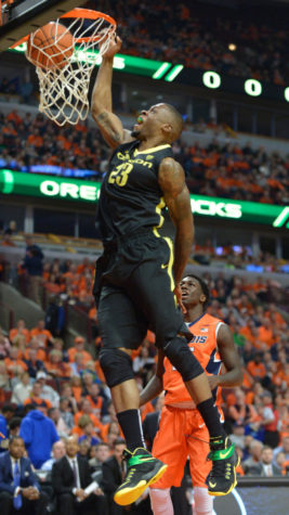 Oregon's Elgin Cook dunks the ball against Illinois at United Center in Chicago on Saturday. The loss to Oregon leaves Illinois with no chance for a marquee win in nonconference play.