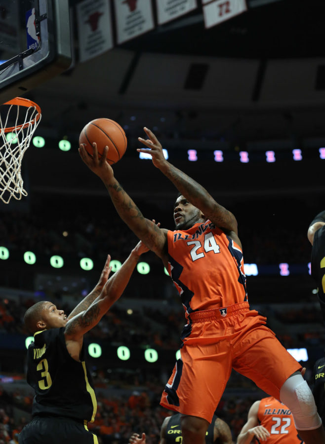 Illinois' Rayvonte Rice (24) attempts a layup during the game against Oregon at United Center in Chicago, Illinois on Dec.13, 2014. The Illini lost 70-77.