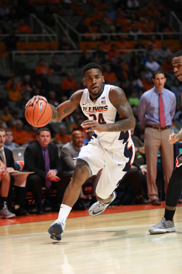 Illinois%27+Rayvonte+Rice+%2824%29+drives+towards+the+basket+during+the+game+against+Brown+at+State+Farm+Center%2C+on+Nov.+24%2C+2014.+The+Illini+won+89-68.