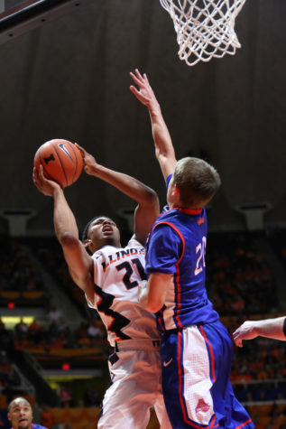 Illinois' Malcolm Hill (21) attempts a contested shot during the game against American at State Farm Center, on Dec.6, 2014. The Illini won 70-55.