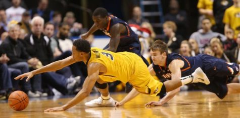 Missouri's Johnathan Williams III reaches for a loose ball against Illinois' Kendrick Nunn and Jon Ekey in the second half of the 2013 Braggin' Rights game at the Scottrade Center in St. Louis. Illinois won last year's eidtion, 65-64. The teams will meet again Saturday.