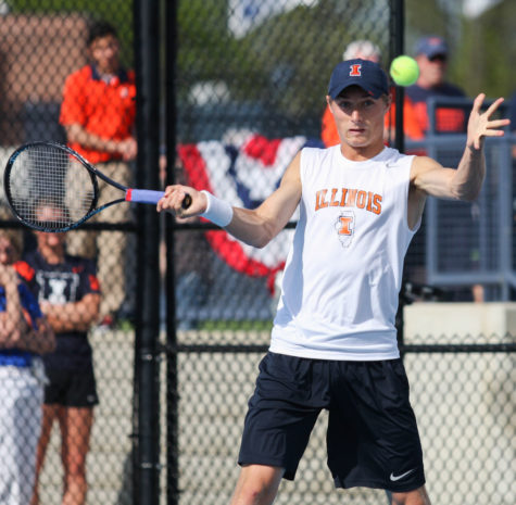 Illinois' Tim Kopinski prepares to hit the ball back during the first round of NCAA Tennis Regionals against Ball State University at Khan Outdoor Tennis Complex on Friday, May 9, 2014. The Illini won 4-0.