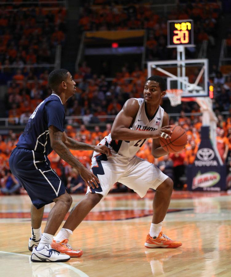 Illinois' Malcolm Hill (21) looks for space while protecting the ball during the game against Penn State at State Farm Center on Jan. 31, 2015. The Illini won 60-58.