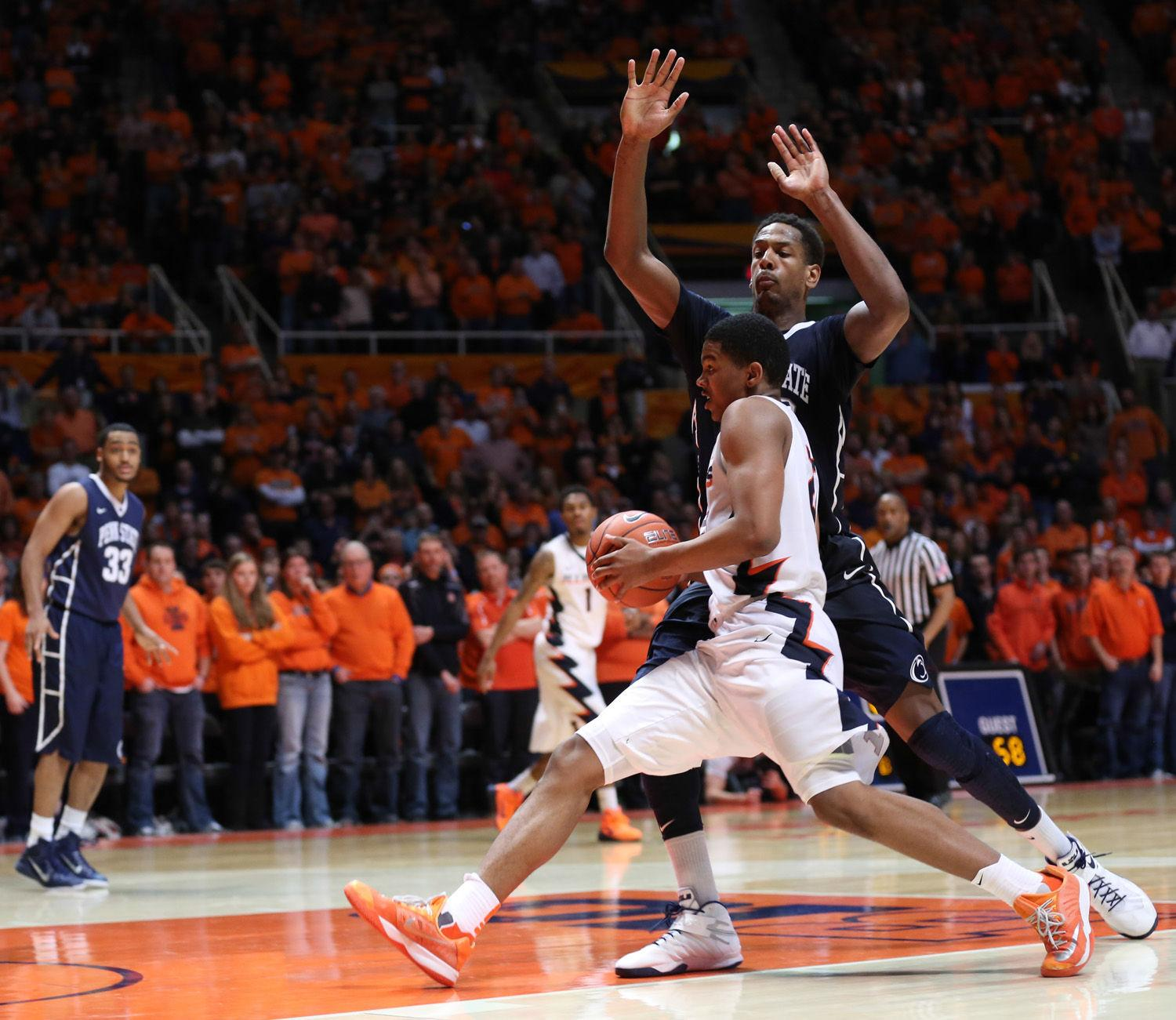 Illinois' Malcolm Hill (21) drives into the paint before making the game-winning basket during the game against Penn State at State Farm Center on Jan. 31, 2015. The Illini won 60-58.