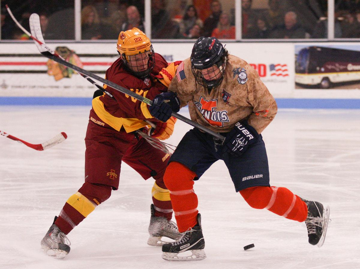 Illinois' Kyle Varzino (27) and Iowa's Alec Wilhelmi (22) both look for the puck during the game against Iowa State at the Ice Arena on Nov. 14. Illinois won 3-1.