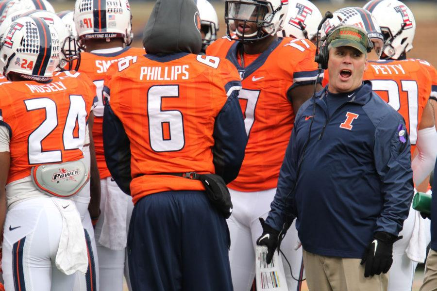 Illinois%E2%80%99+head+coach+Tim+Beckman+speaks+to+a+team+trainer+during+the+game+against+Iowa+at+Memorial+Stadium+on+Nov.+15.+The+Illini+lost+30-14.
