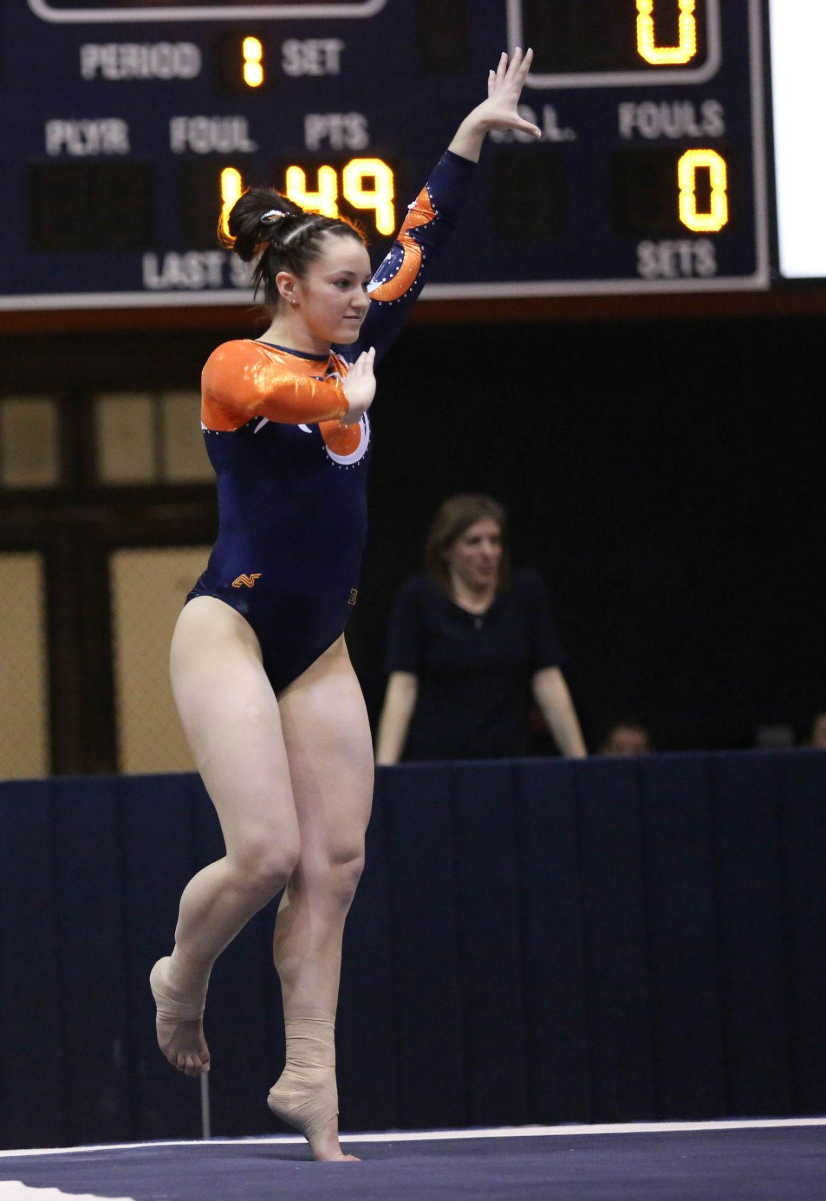 Illinois' Kelsi Eberly performs her floor routine during the meet against Michigan, at Huff Hall, on Friday, Feb.7, 2014 The Illini lost 195.800-195.575