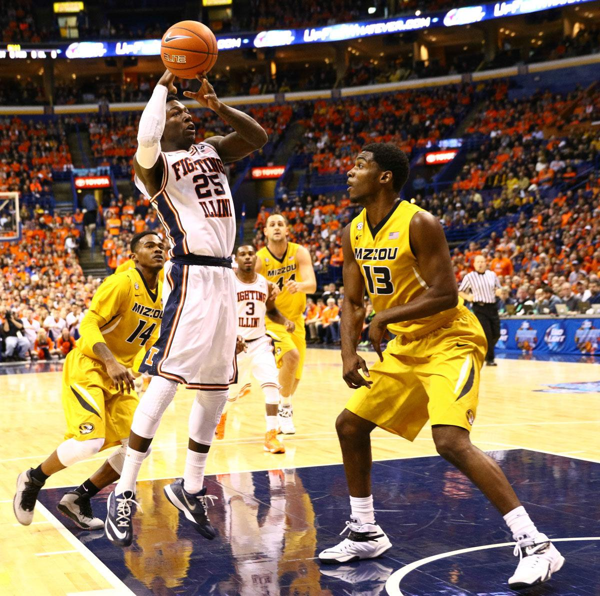 Illinois' Kendrick Nunn (25) loses control of ball after driving to the basket during the game against Missouri at Scottrade Center in St. Louis, Missouri on Dec. 20, 2014. The Illini won 62-59.