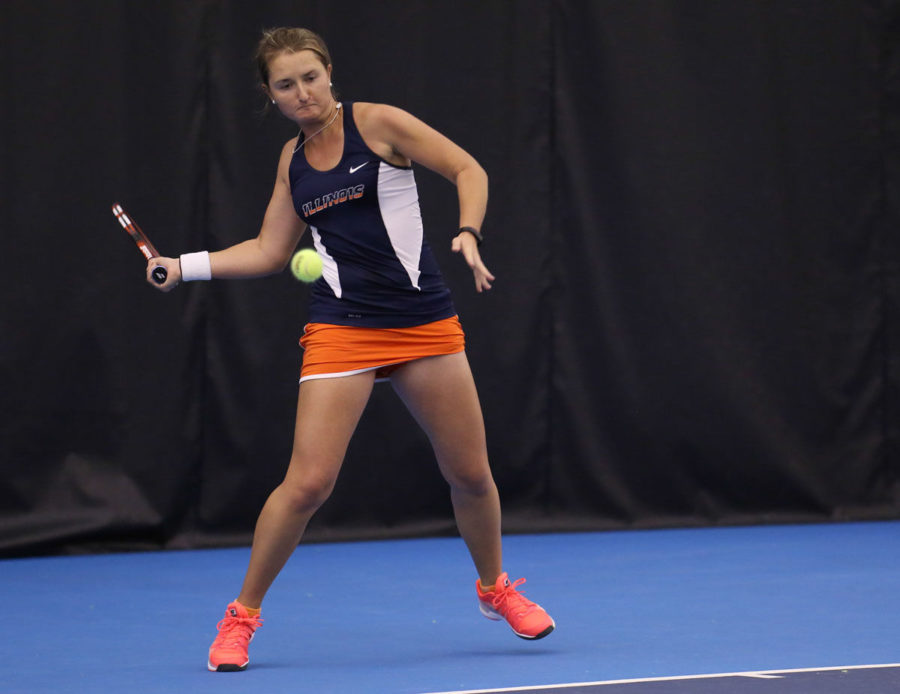 Illinois' Melissa Kopinski prepares to return the ball during the meet against Illinois State at Atkins Tennis Center on Sunday. The Illini won 7-0.