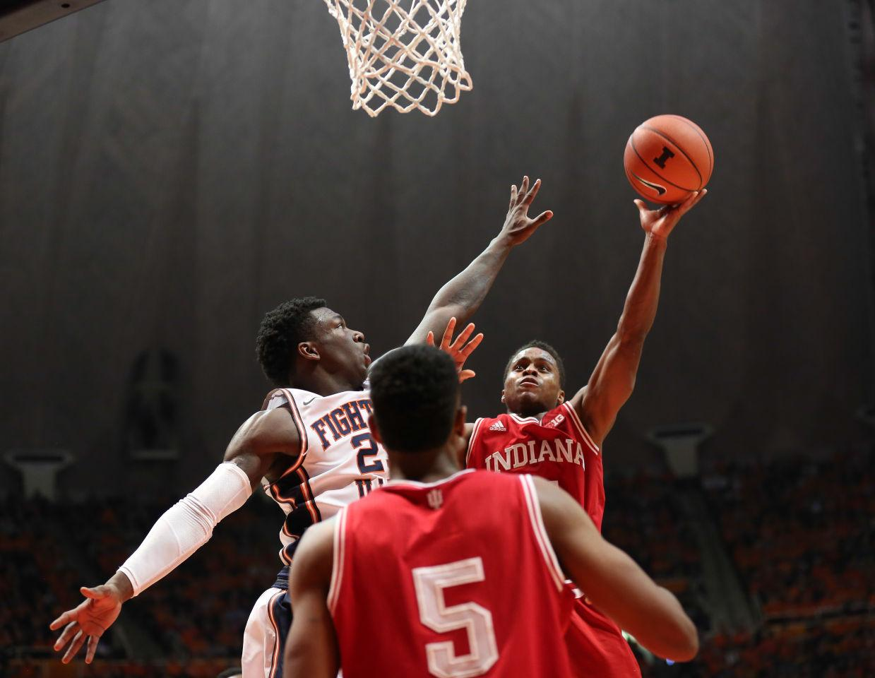 Illinois' Kendrick Nunn (25) attempts to stop Indiana's Yogi Ferrell's (11) attempt on basket during the game against Indiana at State Farm Center on Jan. 18, 2015. The Illini lost 80-74.