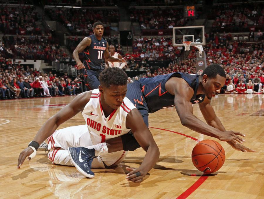 Ohio State's Jae'Sean Tate (1) and Illinois' Ahmad Starks battle for a lose ball during the first half at Value City Arena in Columbus, Ohio, on Saturday, Jan. 3, 2014. The host Buckeyes won, 77-61.