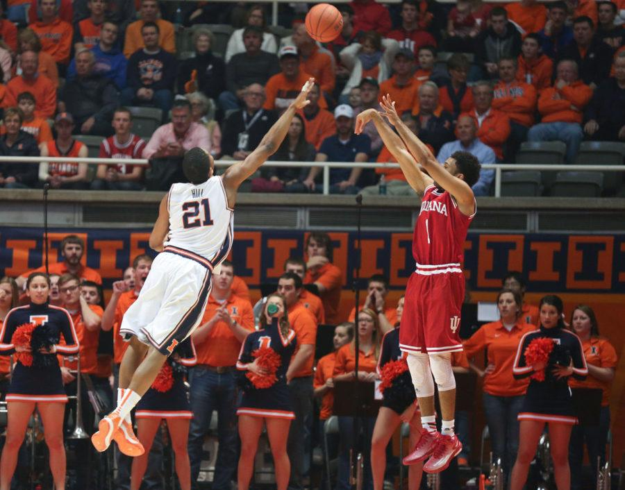 Illinois' Malcolm Hill attempts to defend Indiana's James Blackmon, Jr., during the game against Indiana at State Farm Center on Sunday. The Illini lost 80-74.
