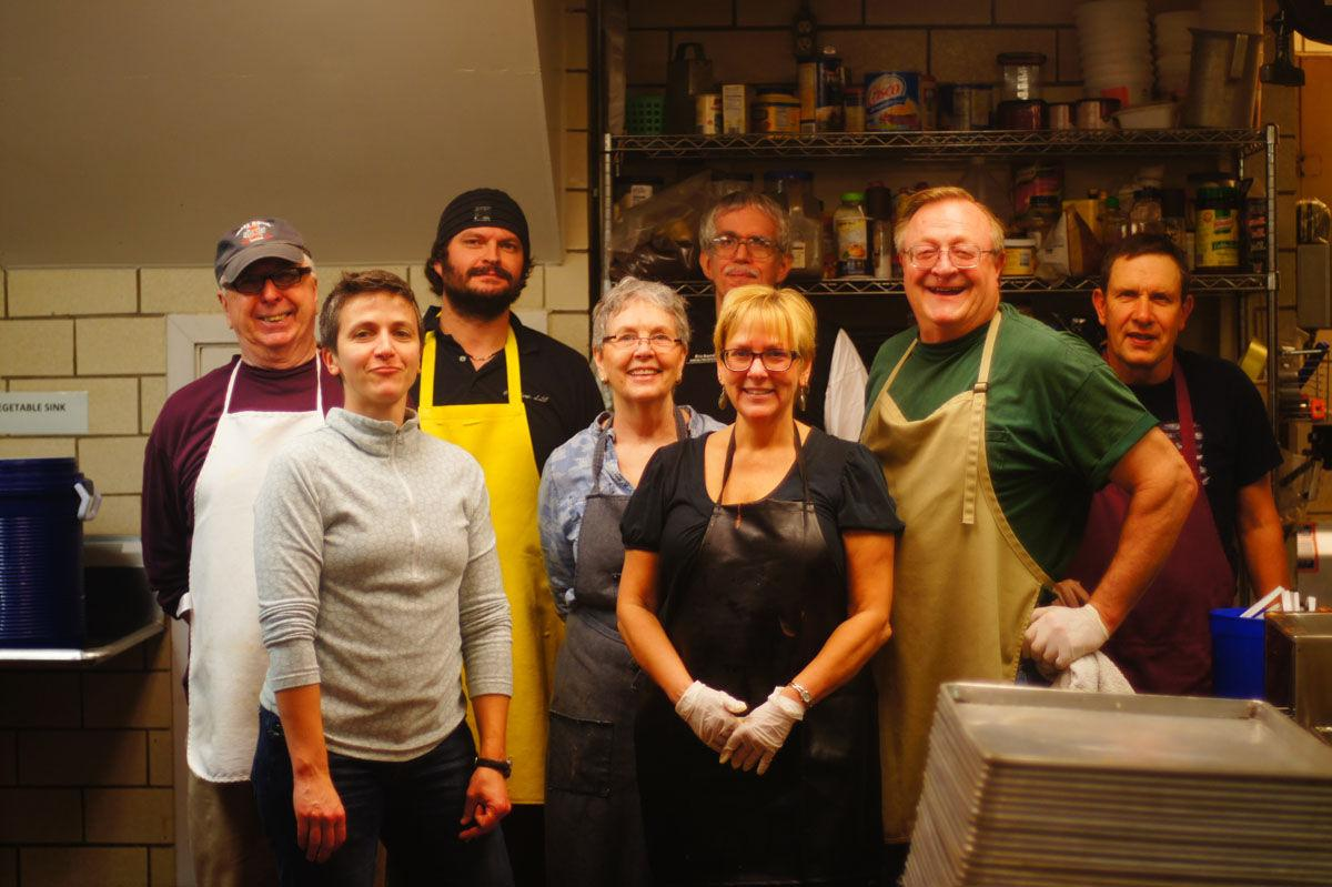 Ellen McDowell (center) stands with a group of volunteers as the director of the Daily Bread Soup Kitchen of 35 years.