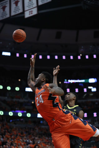 Illinois' Rayvonte Rice attempts a shot against Oregon at United Center in Chicago on Dec. 13. Head coach John Groce said Rice could return Saturday against Penn State. The senior has not played since Jan. 3.