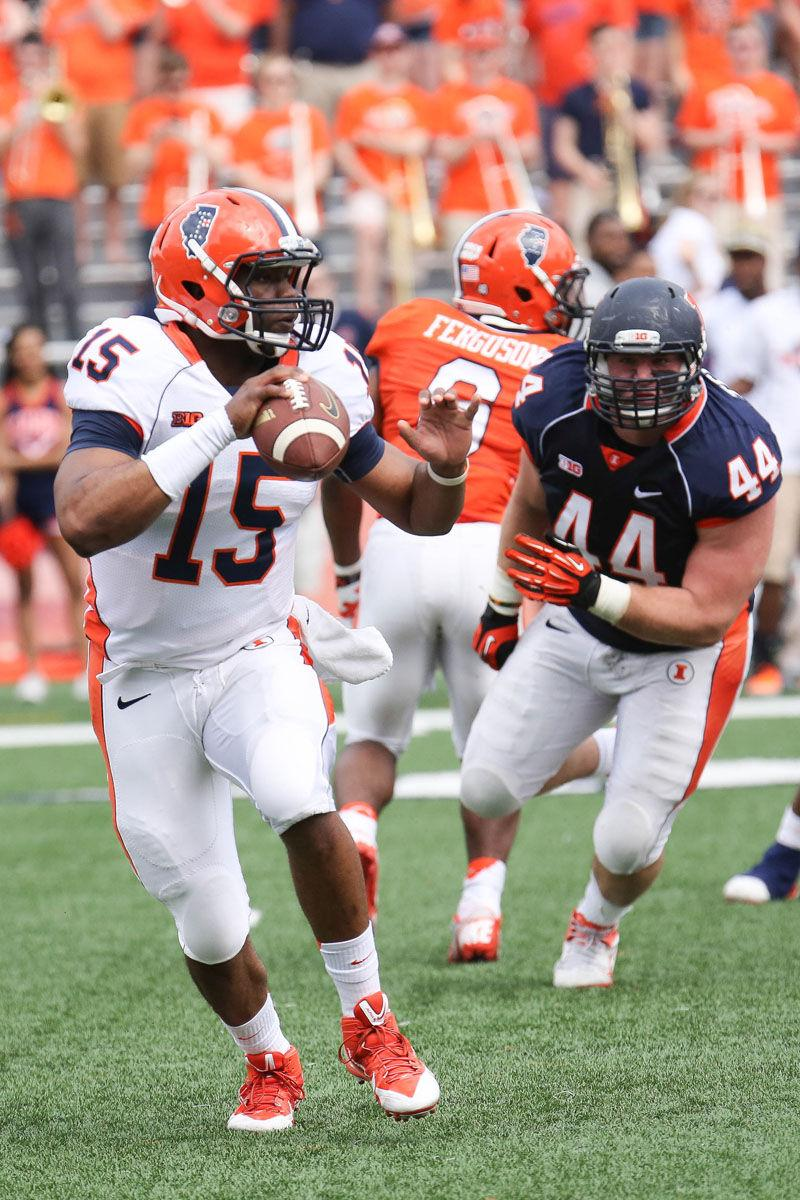 Illinois' Aaron Bailey (15) looks for an open pass during the annual Orange and Blue Spring Game at Memorial Stadium, on Saturday, April 13, 2014. The Blue team won 38-7.