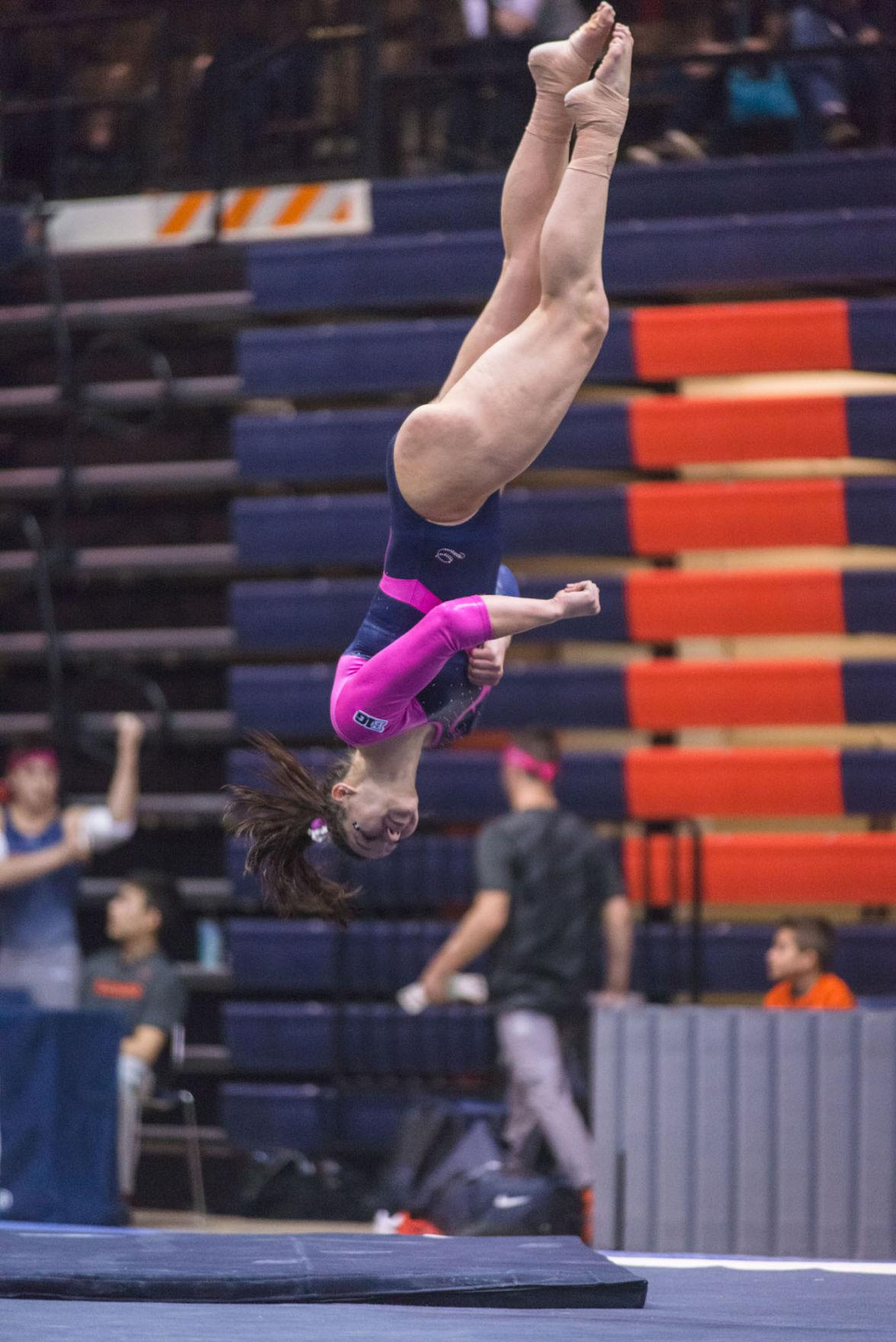 Illinois' Kelsi Eberly performs a floor routine during the match against Penn State at Huff Hall on Feb. 1.