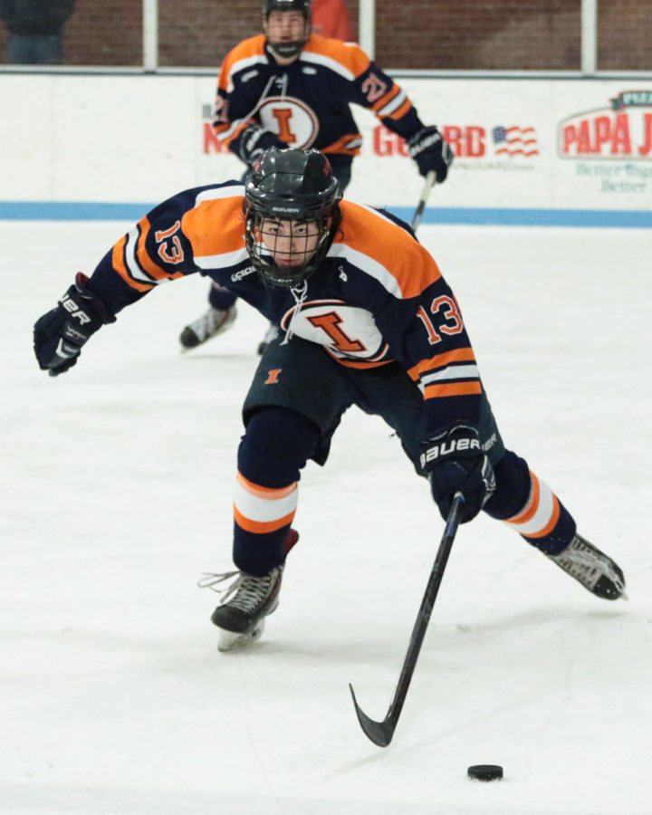 Illinois%27+James+Mcging+%2813%29+looks+for+an+open+pass+during+the+CSCHL+Playoffs+semi-finals+v.+Ohio+University+at+the+Ice+Arena+on+Saturday%2C+Feb.+21%2C+2015.+Illinois+lost+3-5.