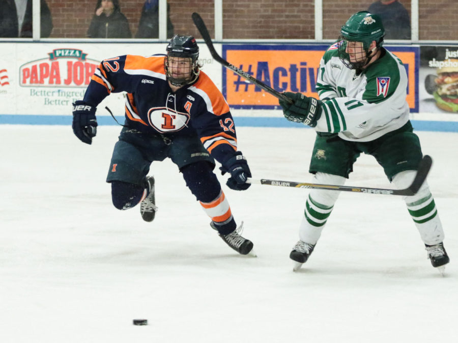Illinois' Jonathan Langan follows the puck after Ohio's Michael Harris pass it during the CSCHL Playoffs semi-finals v. Ohio University at the Ice Arena on Saturday.