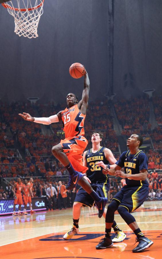 Illinois%27+Kendrick+Nunn+%2825%29+rises+while+attempting+to+finish+a+fast-break+with+a+dunk+during+the+game+against+Michigan+at+State+Farm+Center%2C+on+Feb.+12%2C+2014.+The+Illini+won+64-52.