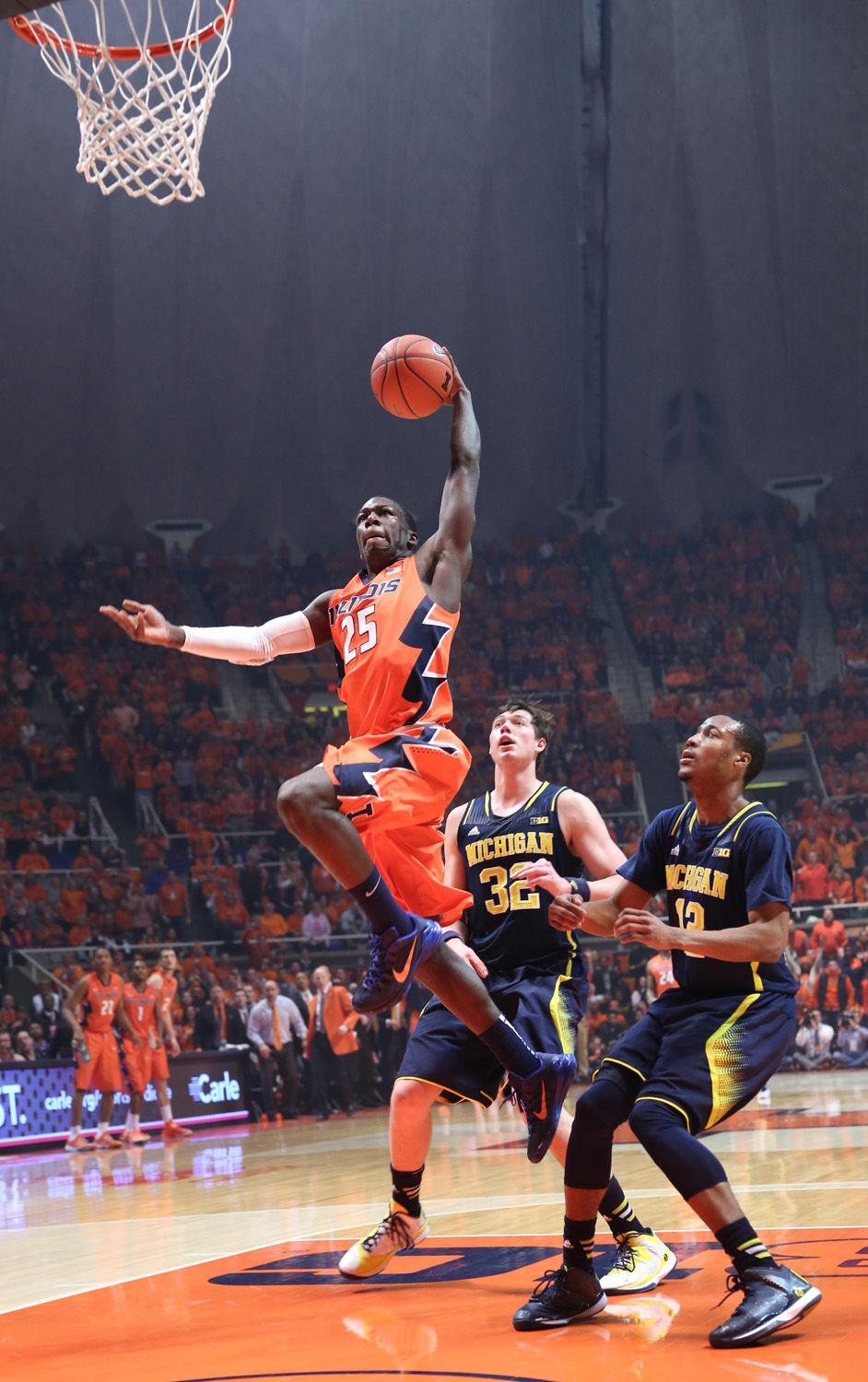 Illinois' Kendrick Nunn (25) rises while attempting to finish a fast-break with a dunk during the game against Michigan at State Farm Center, on Feb. 12, 2014. The Illini won 64-52.